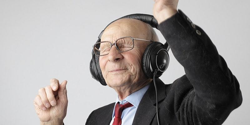 image of an older person enjoying music